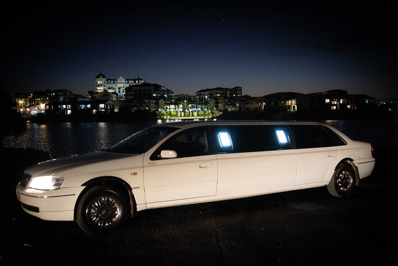 7 Seater Ford Fairlane Stretch Limo Side View At Night