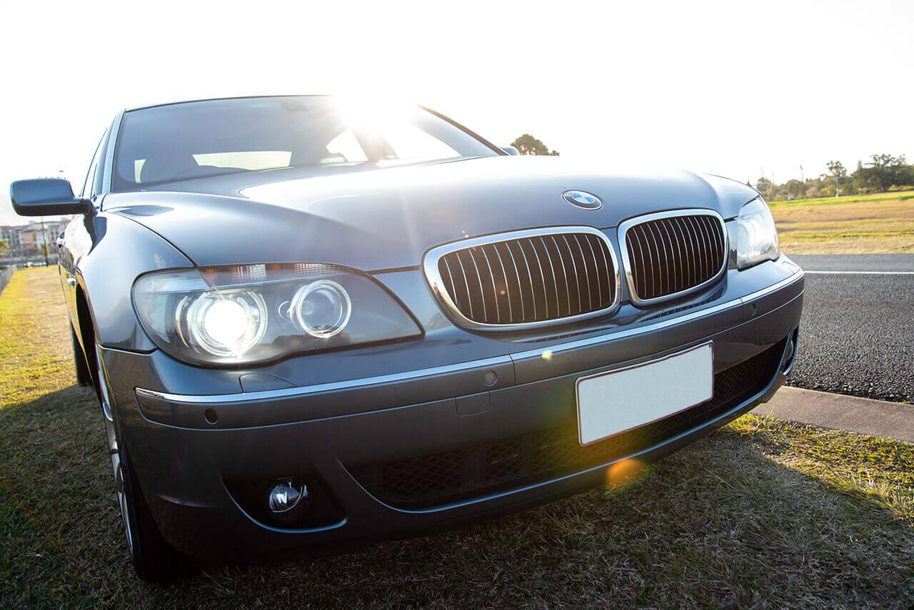 BMW 750 Li Greyfront shot with lights on