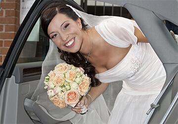 bride looking in wedding car