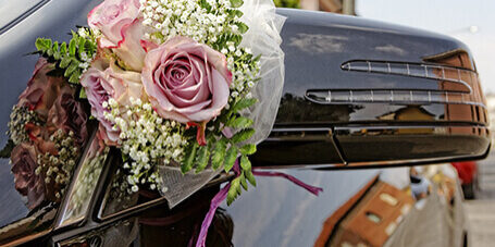 bouquet on boot of wedding car for hire